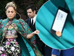 FASHION FAILS! Jennifer Lopez stuns when she arrives at a fashion event in Venice, wearing a cape. But she leaves the PRICE TAG