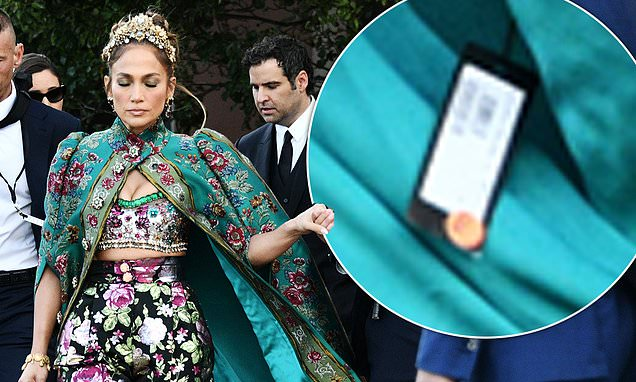 Jennifer Lopez stuns as she arrives at fashion event in Venice wearing a cape – but leaves the PRICE TAG on